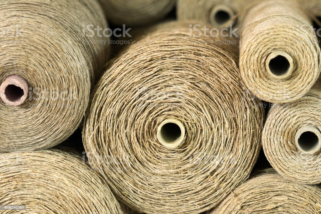 close up view of spools of brown thread used for weaving stock photo