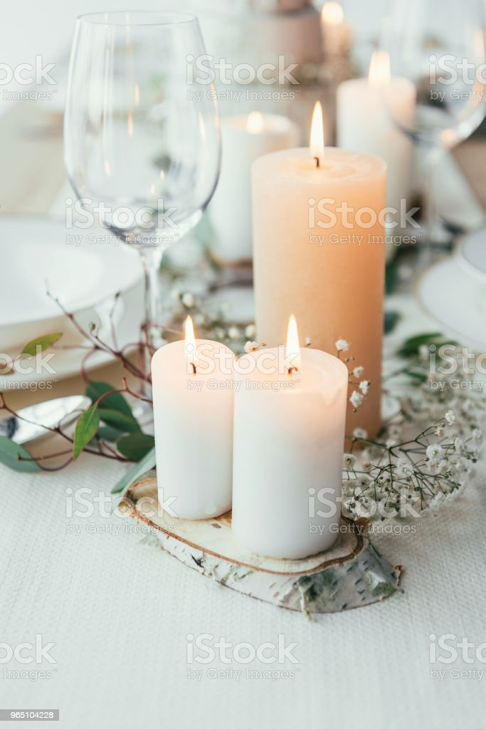close up view of stylish table setting with candles and flowers for rustic wedding royalty-free stock photo