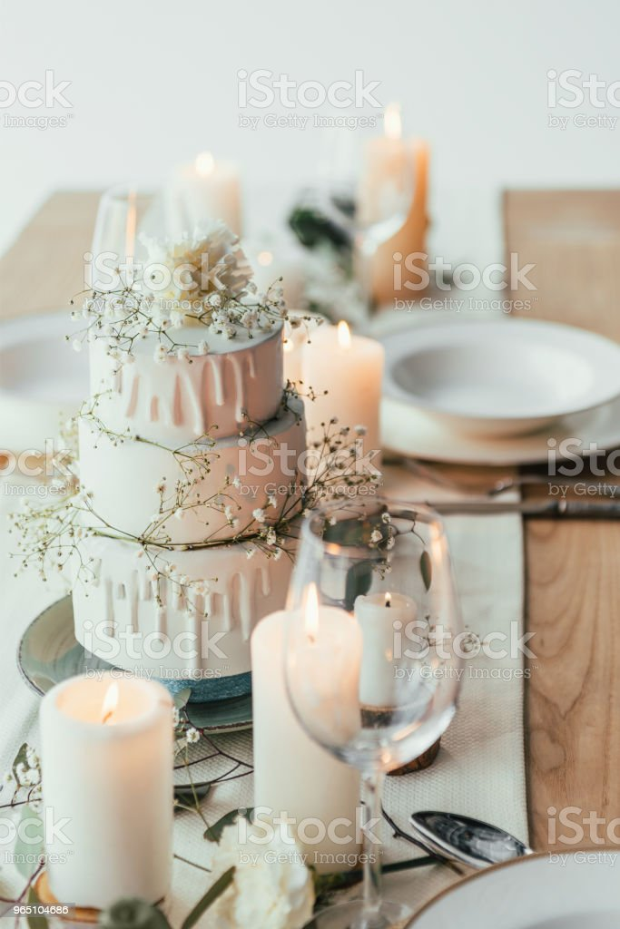 close up view of stylish table setting with candles and wedding cake for rustic wedding zbiór zdjęć royalty-free