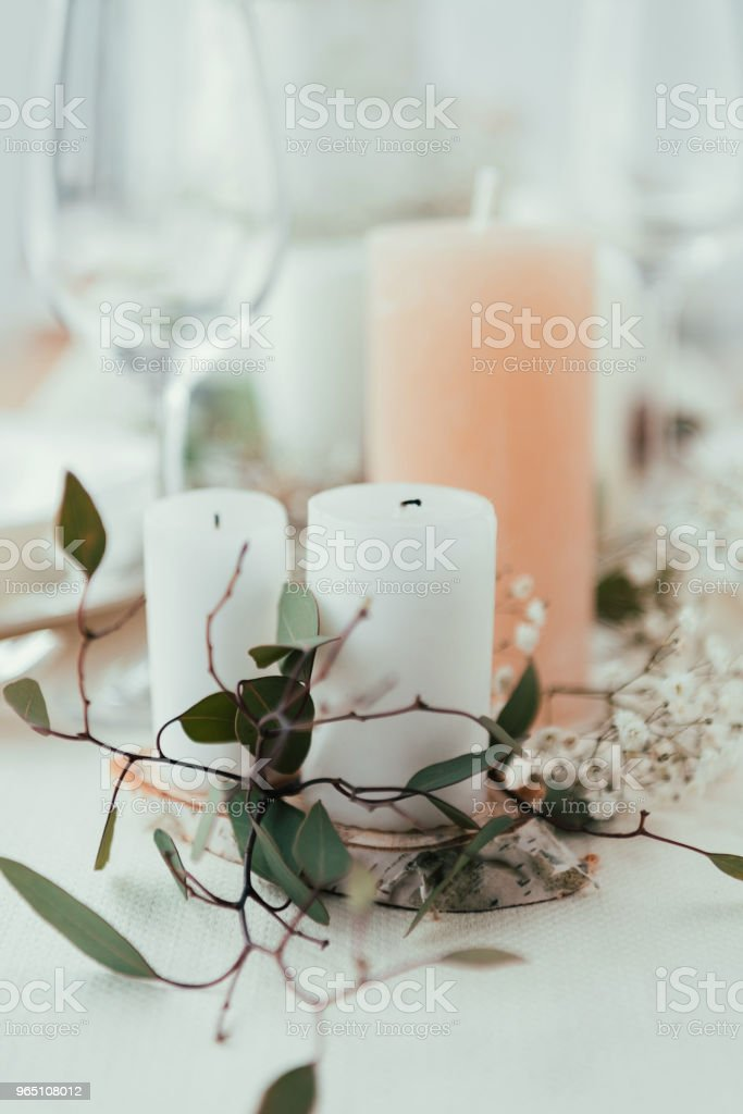 close up view of stylish table setting with candles, flowers and eucalyptus for rustic wedding zbiór zdjęć royalty-free