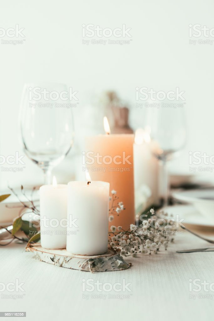close up view of stylish table setting with candles, wineglasses and flowers for rustic wedding zbiór zdjęć royalty-free