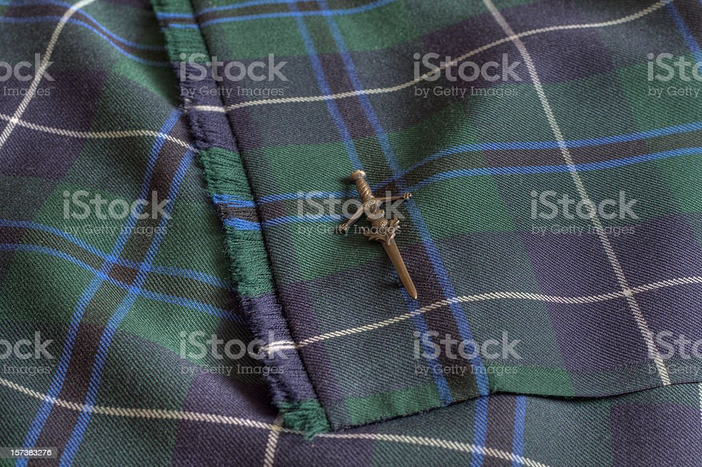 Close up view of Tartan Kilt and kiltpin. royalty-free stock photo