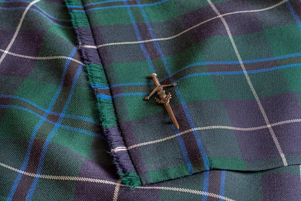 Close up view of Tartan Kilt and kiltpin. stock photo