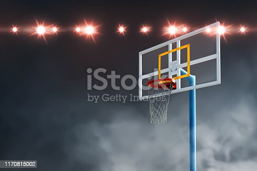 518943593istockphoto Close up view of the basketball hoop with spotlights 1170815002
