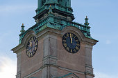 Stockholm, Sweden - October 19 2018: close up view of the clock tower tower of Saint Nicholas Church or Storkyrkan on October 19 2018 in Stockholm Sweden.
