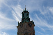 Stockholm, Sweden - October 19 2018: close up view of the tower of Saint Nicholas Church or Storkyrkan on October 19 2018 in Stockholm Sweden.