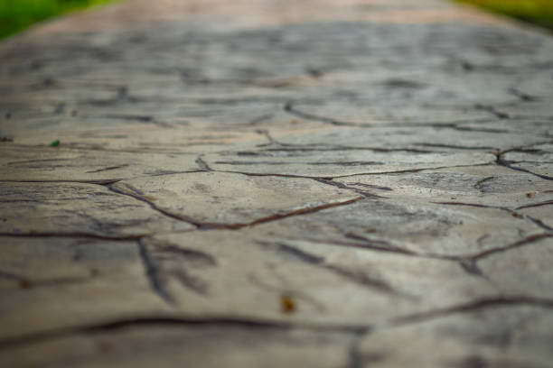 Close up view of walkway concrete stamped material, selective focus. Close up view of walkway concrete stamped material, selective focus. rubber stamp stock pictures, royalty-free photos & images