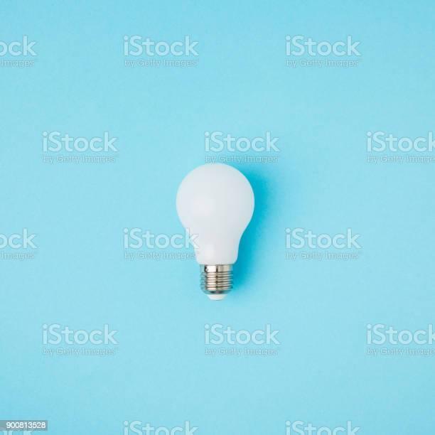 Close up view of white light bulb isolated on blue picture id900813528?b=1&k=6&m=900813528&s=612x612&h=ipsbrdtlduddmk8f1rh zxfnmgy vvtx ks9fgme0w8=