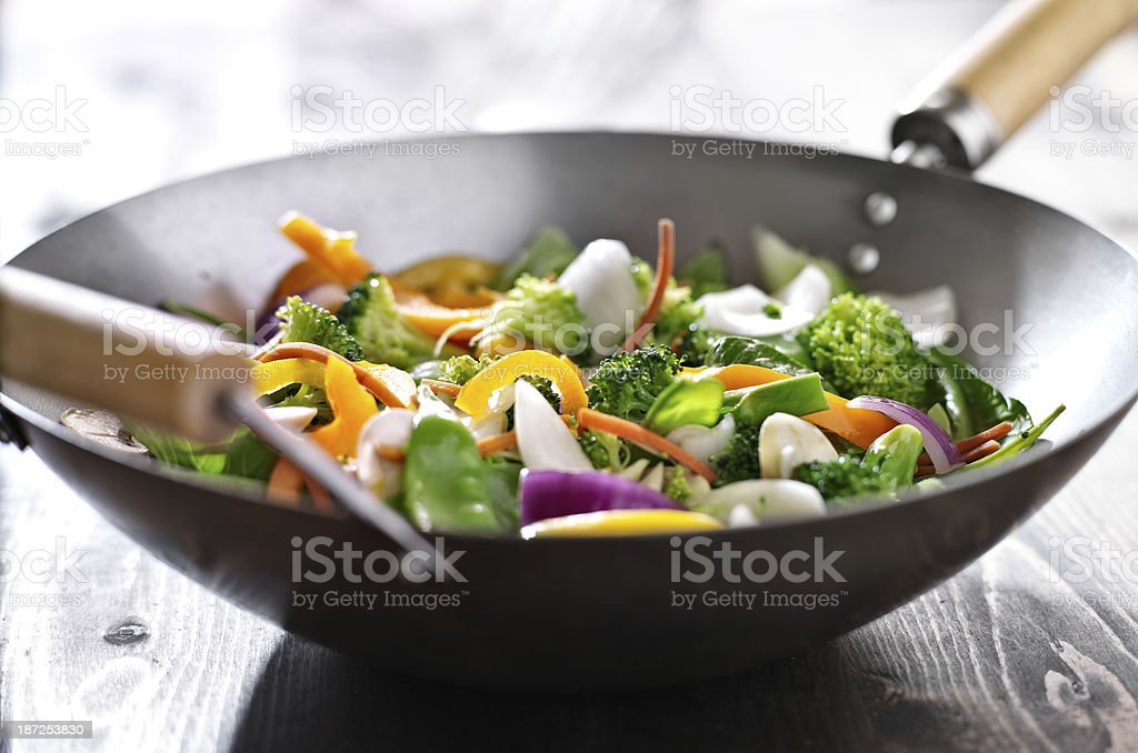 Close up view of wok with vegetarian stir fry  stock photo
