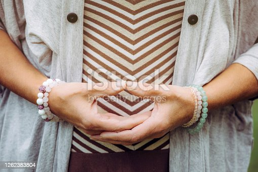 Close up view of woman hands doing meditation Dhyana mudra gesture also known as Samadhi mudra.