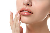 istock Close up view of young beautiful woman face 915709178