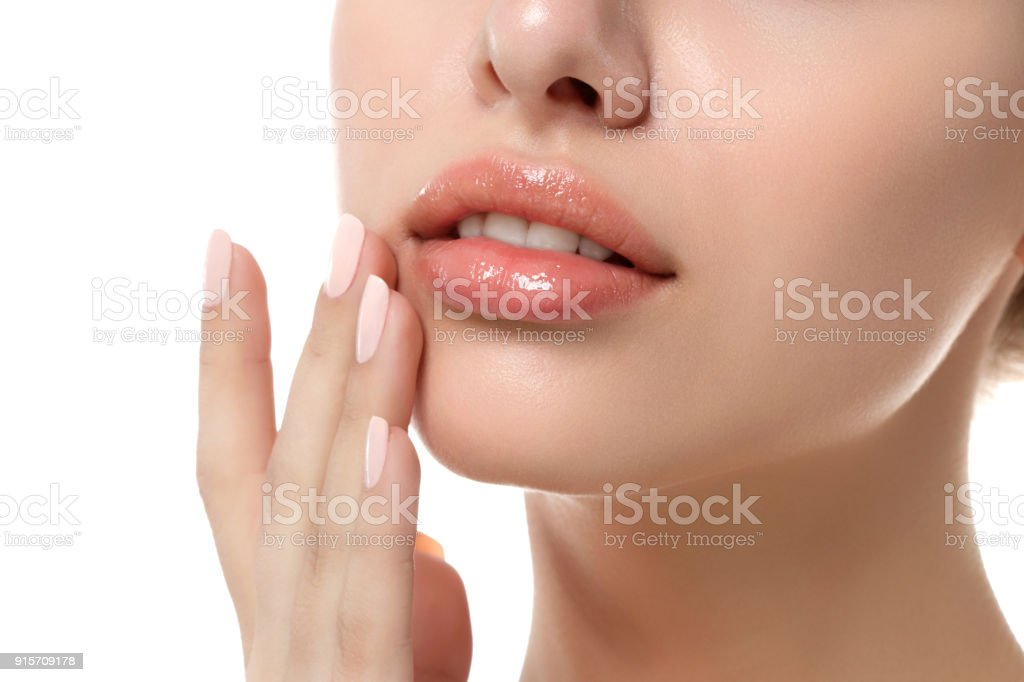 Close up view of young beautiful woman face stock photo