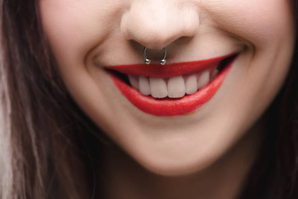 close up view of young girl with red lips and piercing in nose - nose ring stock pictures, royalty-free photos & images