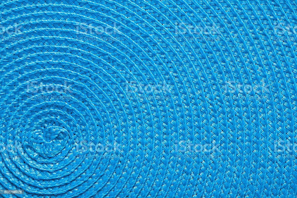 close up view on blue texture of wickered mat stock photo