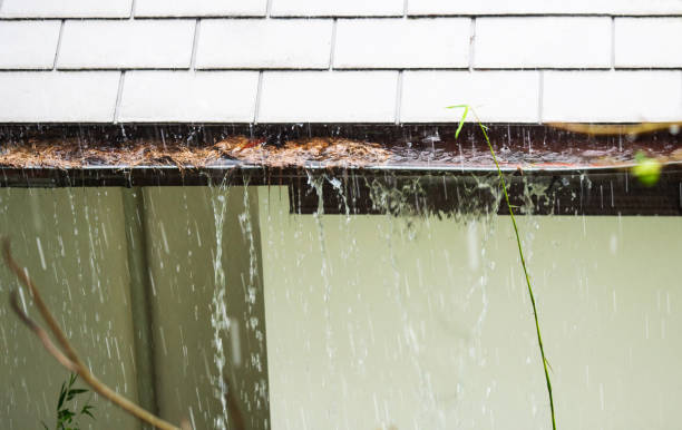 Close up view on clogged Rain Gutter in the rain. Home Guttering, Gutters stock photo