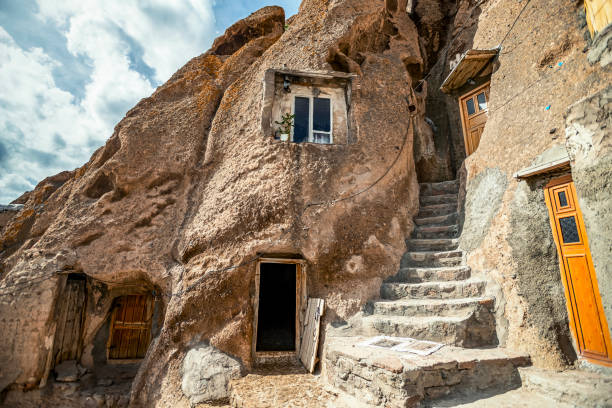 close up view on courtyard and interior of traditional Iranian ancient cave village of troglodyte in Kandovan in East Azerbaijan Province. Iran. near Tabriz city. looks like village in Turkey stock photo