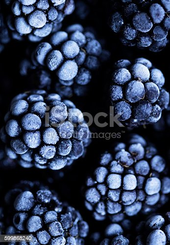 istock Close up view on frozen Blackberry fruits a black stone 599868240