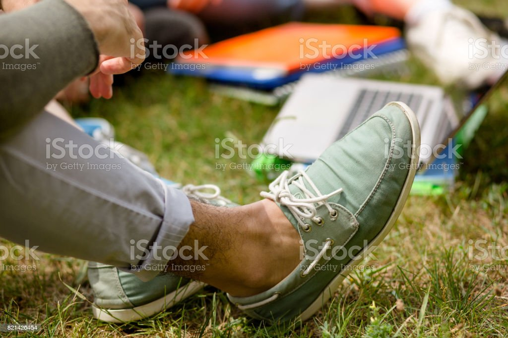 Close up view on mans leg in moccasins. stock photo