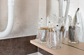 istock Close up view on the bottles with cosmetics and hygienic kit ain the hotel bathroom 938304804