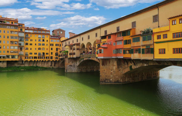 Close up view with architectural details of Ponte Vecchio bridge across Arno river in Florence (Firenze), Tuscany, Italy stock photo