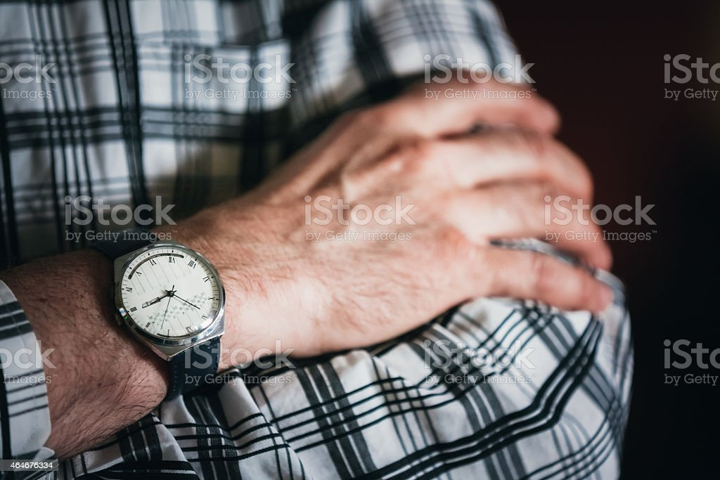 Close Up Vintage Old Watch On Man Hand. Striped Shirt stock photo