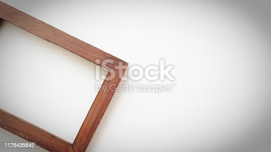 1141440440 istock photo Close up vintage wood frame on white background. 1175435542