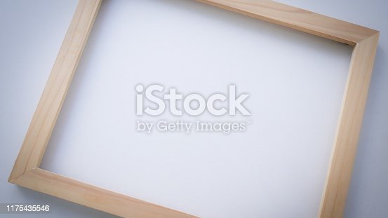 1141440440 istock photo Close up vintage wood frame on white background. 1175435546