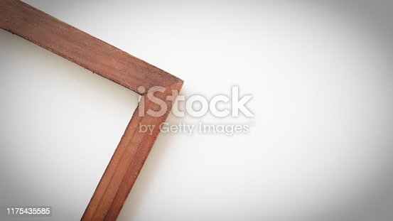 1141440440 istock photo Close up vintage wood frame on white background. 1175435585