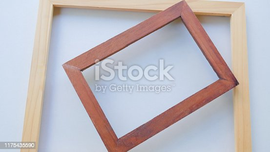1141440440 istock photo Close up vintage wood frame on white background. 1175435590