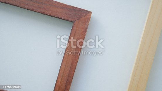 1141440440 istock photo Close up vintage wood frame on white background. 1175435608