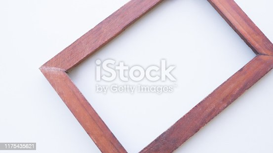 1141440440 istock photo Close up vintage wood frame on white background. 1175435621