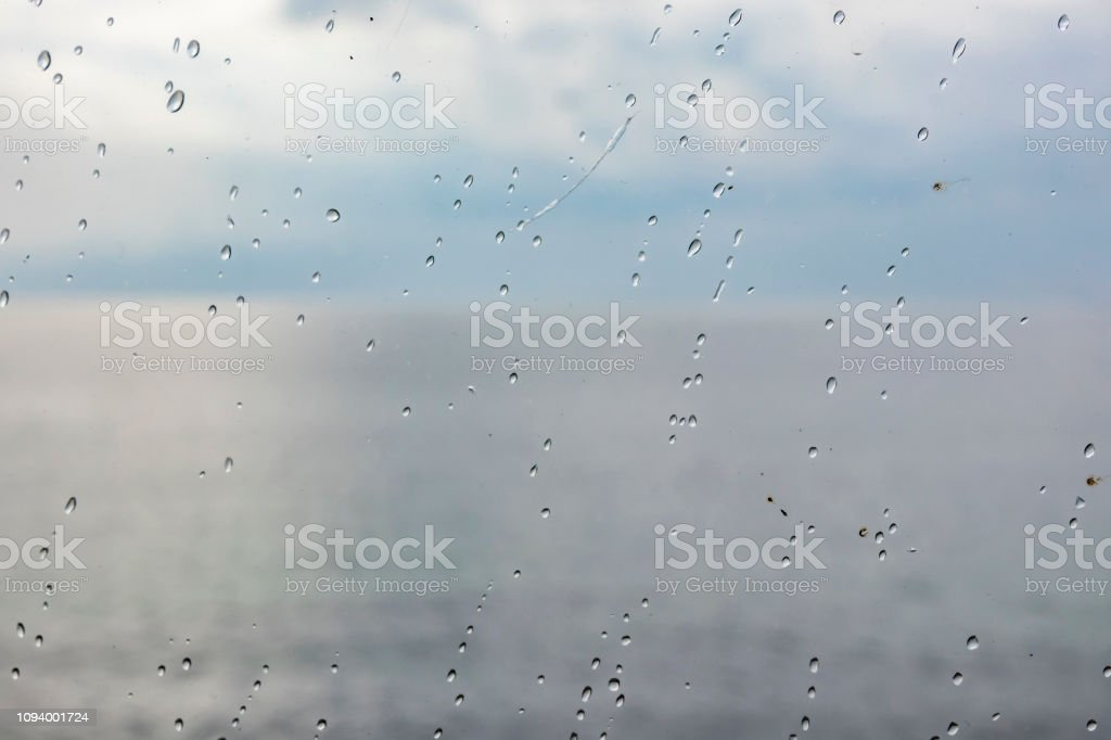 close up water droplets on window glass surface stock photo
