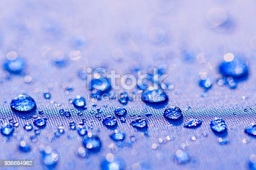 istock Close up Water drops pattern over a blue waterproof cloth background. World Water Day concept. 936664962