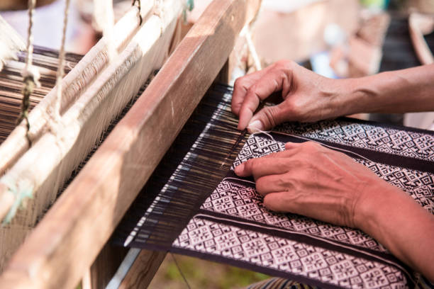 Close up Weavers are weaving with a loom and threading. stock photo