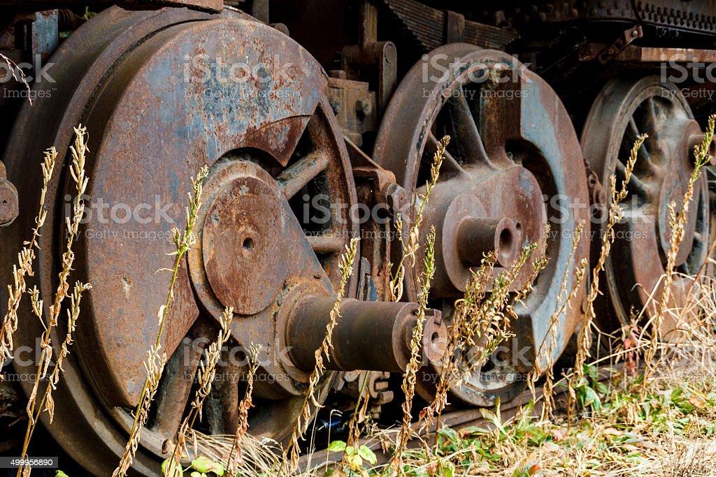 Close up wheels on abandoned stream powered locomotive. stock photo