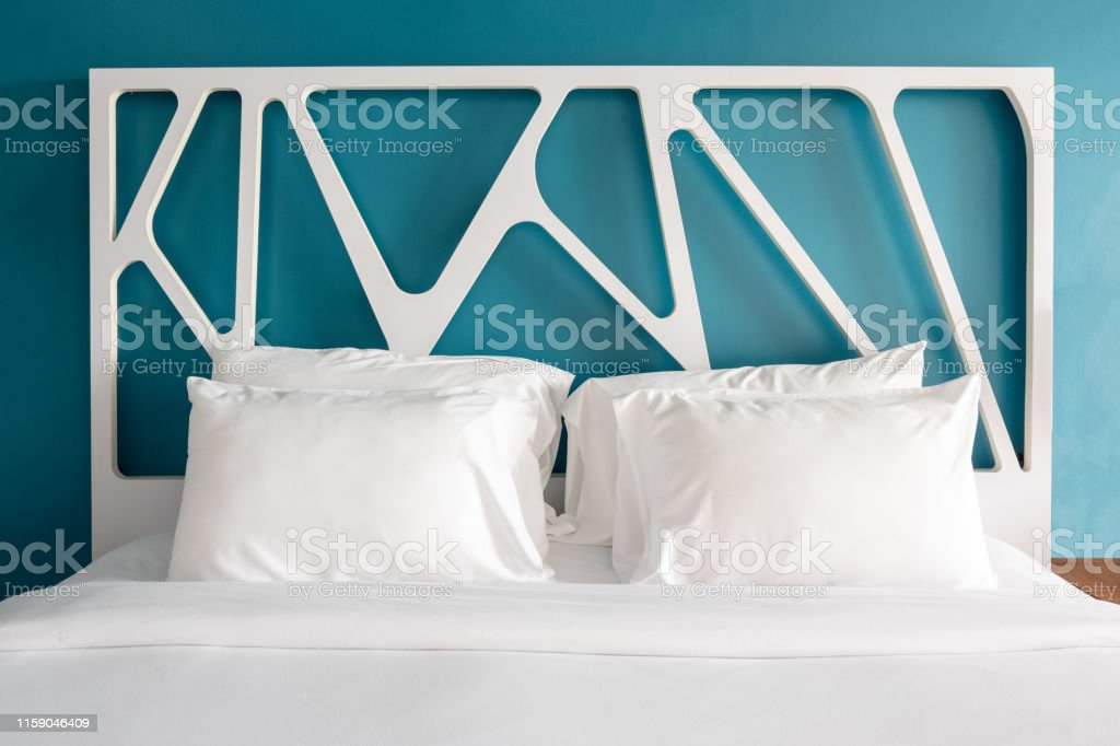 Close up white bedding sheets and pillow in modern bedroom. Front...