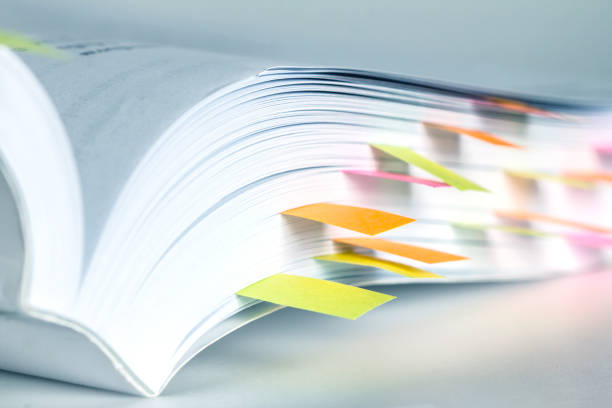 Close up White book marked by sticky note stock photo