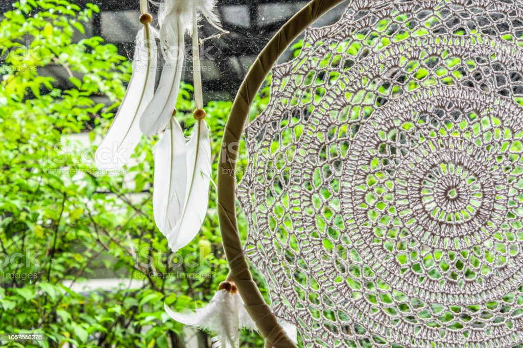 Close up white dream catcher at the home garden. stock photo