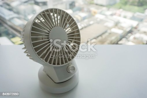 istock close up white portable USB desktop fan plug in with computer office 843972550