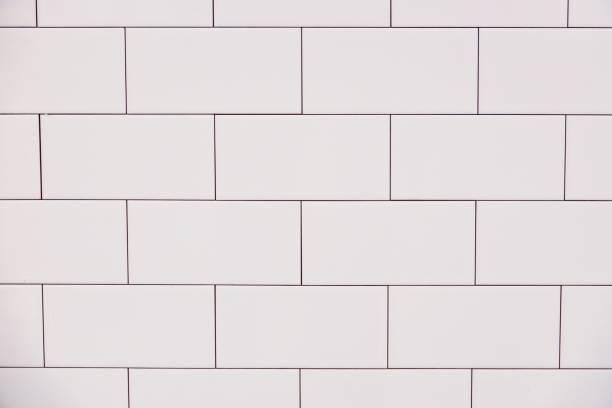 close-up witte vintage keramische baksteen tegel muur - tegel stockfoto's en -beelden