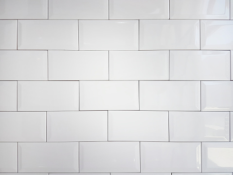 Close up white vintage ceramic brick tile wall