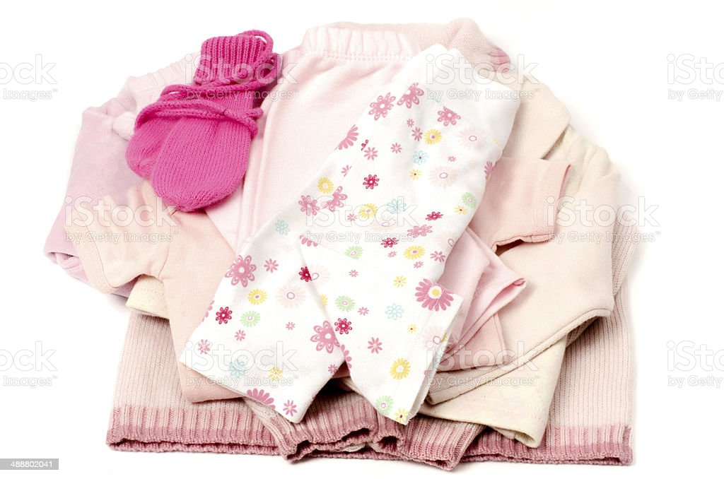 Close up with a pink stack of clean baby clothes stock photo