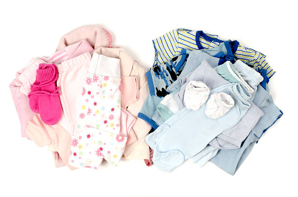 Close up with blue,pink stack of clean baby clothes stock photo