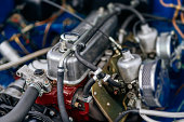 Close up with selective focus on vintage car engine block under open hood