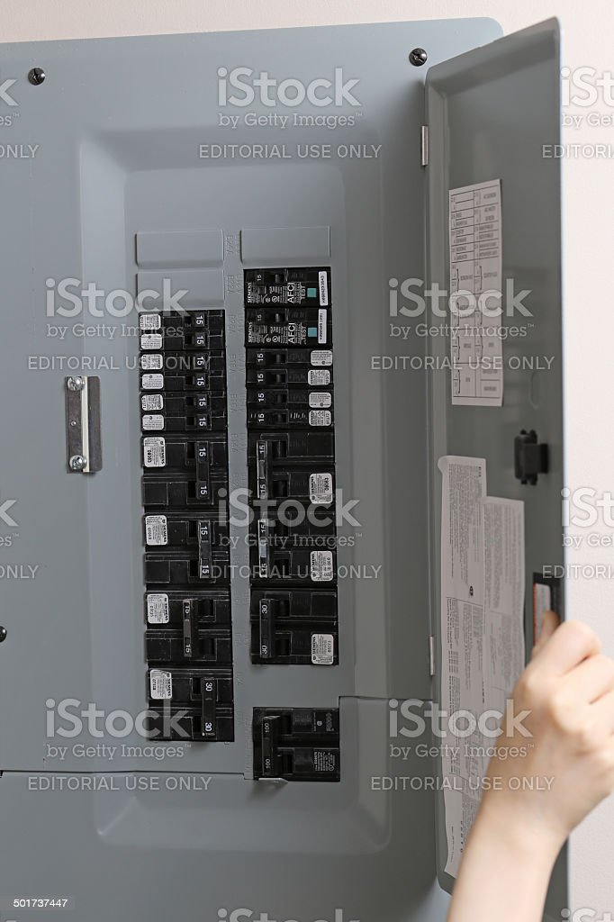 Close up woman checking electricity distribution box stock photo