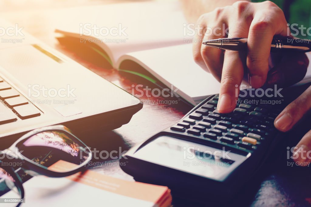 Close up woman doing finance with calculate expenses. stock photo