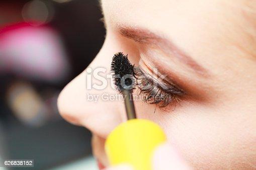 istock Close up woman getting make up, mascara 626838152