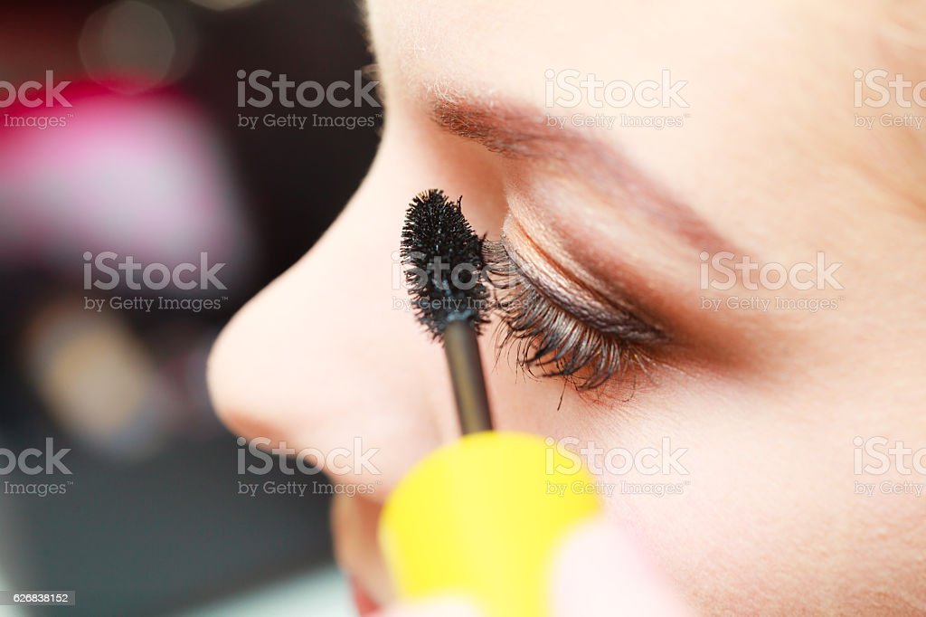 Close up woman getting make up, mascara stock photo