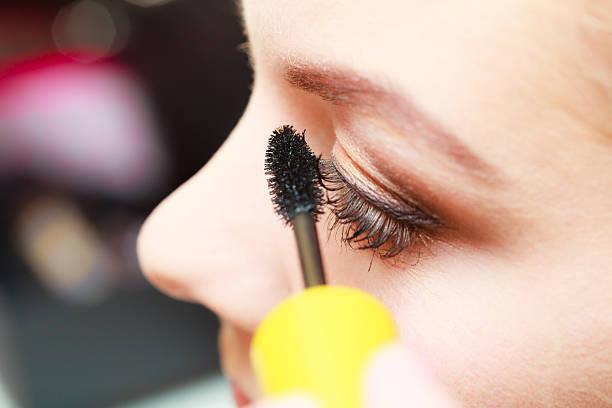 Close up woman getting make up, mascara ストックフォト