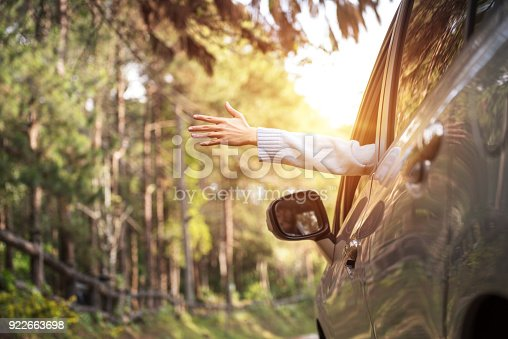 istock Close up woman hand relaxing and enjoying road trip. 922663698